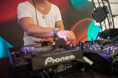 MOSCOW - 19 JUNE,2016: Party Dj play on music festival.Digital turntable player,sound technology for disc jockey to mix tracks.Midi controller mixer.Dj audio equipment for concert.