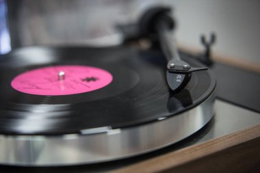 MOSCOW - 25 FEBRUARY, 2017: Big turntable vinyl records player expo in Nota salon. Exposition sale of hifi audio equipment for sound enthusiasts .Analog turn table vinyl sound system. Handmade hi-fi player