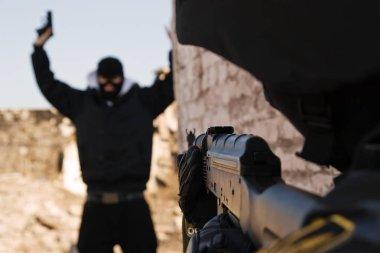 Military policeman taking armed criminal under arrest