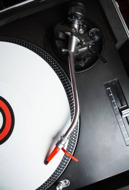 Vintage turntable record player in close up.Retro analog turn table device plays vinyl disc with music.Hipster audio equipment.