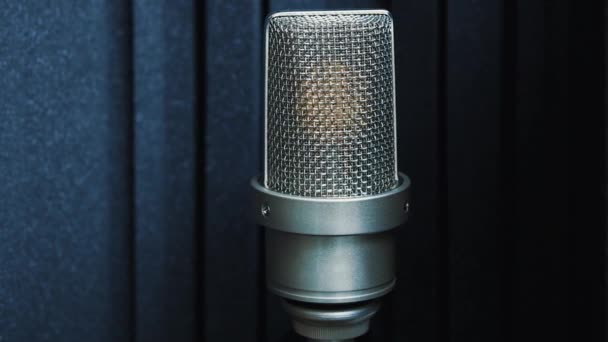 Photo Footage of professional analog microphone on stand in radio station studio.Record voice  music in high quality and broadcast.