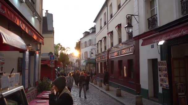 PARIS,FRANCE-30 APRIL,2019:Monmartre district streets at sunset.Popular tourist landmark in Paris at dusk in spring evening.Famous Mon Martre Hill street crowded with international tourists