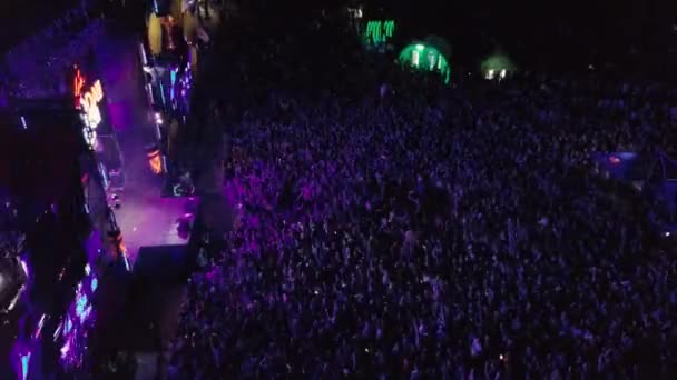 KYIV-25 MAY,2019: Summer music festival crowd partying to famous dj at night.Radio Day Festival event shot from above with aerial drone camera. Popular entertainment event for youth
