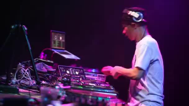 MOSCOW-21 MAY,2016:Dj Kentaro scratching vinyl record on turntable mix music on concert