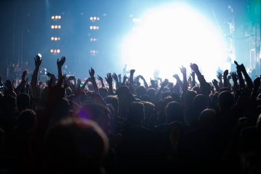Concert stage lights and crowd on dance floor partying to the music