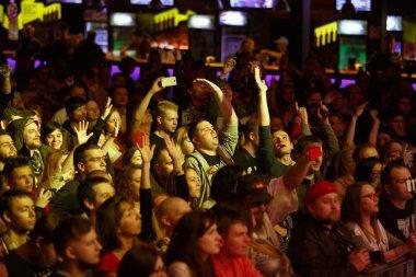 Rap concert audience on dance floor in night club