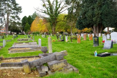 OXFORD, UK - NOVEMBER 13, 2017: Old Wolvercote cemetery in Oxford, England. The final resting place of John Ronald Reuel Tolkien and his wife Edith Mary Tolkien. stock vector
