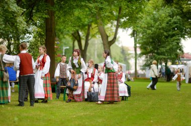 VILNIUS, LITHUANIA - JULY 5, 2014: Participants of Lithuania Song Festival, massive traditional song and dance festival, taking place every four years