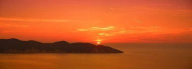 Beautiful sunset colors over the coastline of Cephalonia island, Greece.
