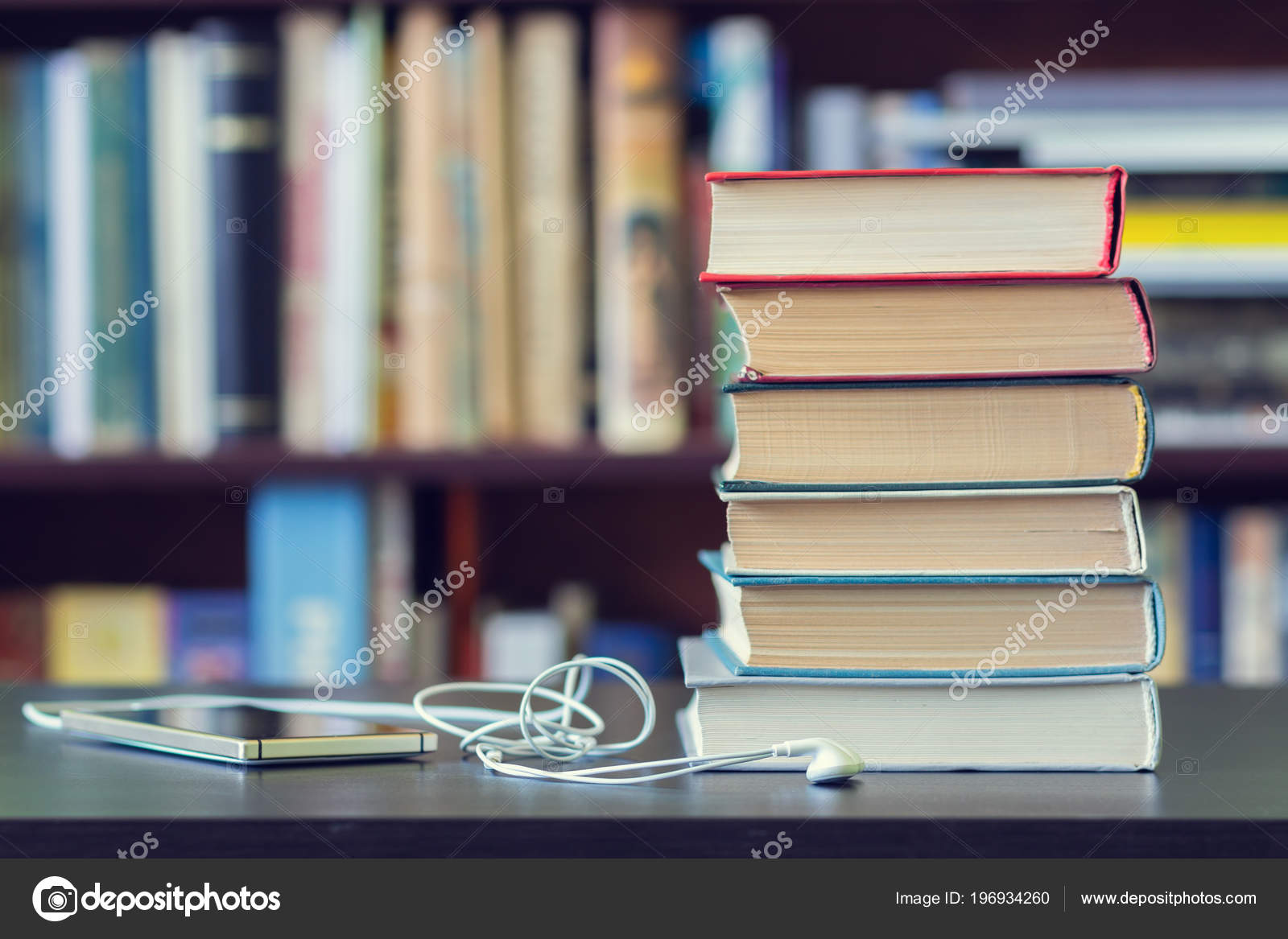 A Stack Of Books And Mobile Phone With Headphones On The Background Bookshelves Photo By Papa42