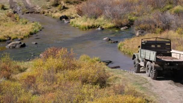 Very old russian truck crossing river Kurkurek on Altai mountain plateau Eshtykel. Siberia, Russia