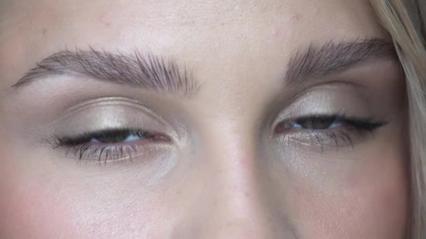 Closeup video of female eyes with day face makeup