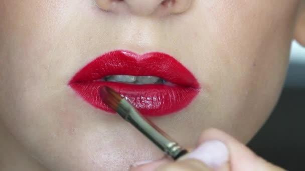 Close-up video of beautiful girl's lips make up