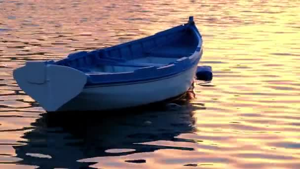 Boat on water of Malta Harbor at sunset time