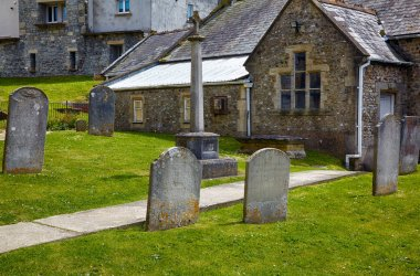 The churchyard of parish church of St Michael the Archangel, above Church Cliff. Lyme Regis. West Dorset. England