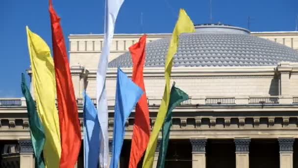 Flags with the roof of Novosibirsk Opera and Ballet theater