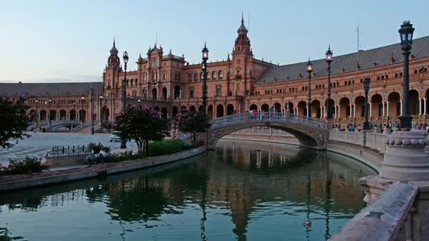 Night view of Spain Square (Plaza de Espana) with bridge reflecing in water of canal. Seville, Spain.