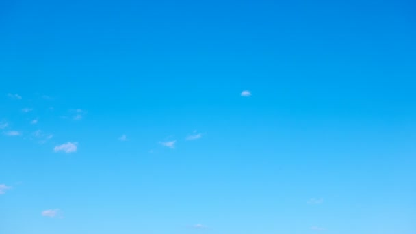 Almost clear blue sky with light white clouds - Seamless loop timelapse 4K