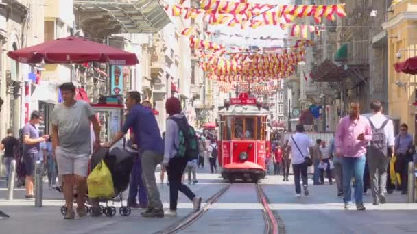 Istanbul, Turkey - July 17, 2018: Historic old tram and walking people in Istiklal pedestrian street in Istanbul