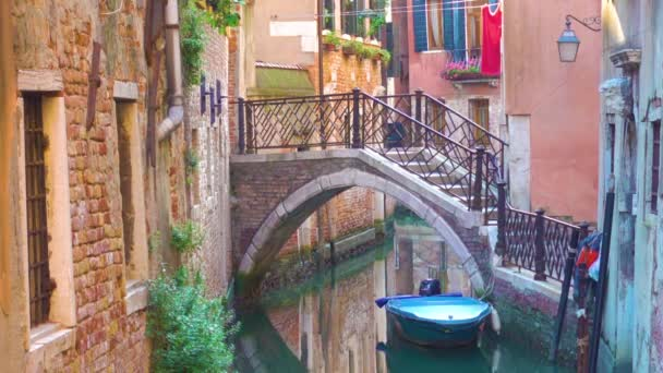 Small side canal and bridge in Venice, Italy