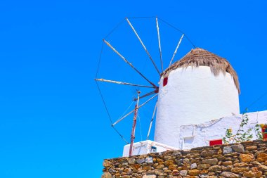 Old white windmill in Mykonos, Greece. Space for text