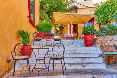 Charming street cafe on the stairs in Plaka district in Athens, Greece stock vector