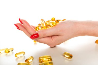 Vitamin Omega-3 fish oil capsules on a hand