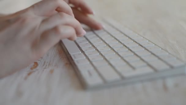 close-up footage of woman typing with wireless keyboard