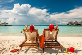Fotografie Couple on a tropical beach in Maldives at christmas