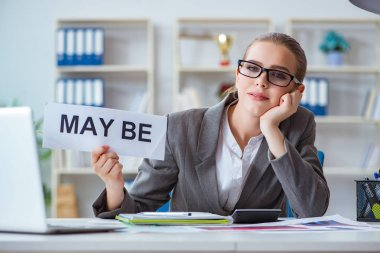 Businesswoman sitting in office with message