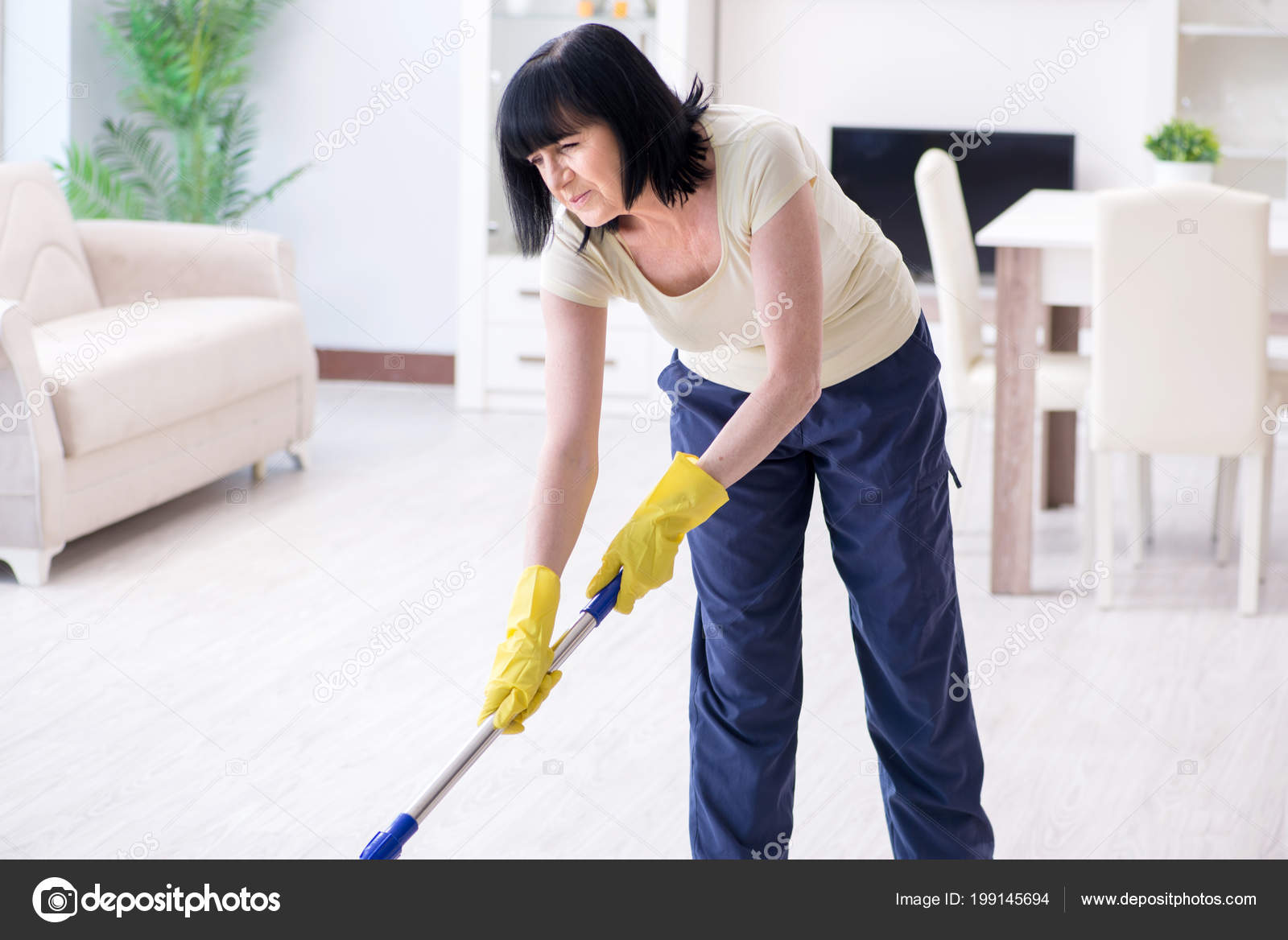 Old Mature Woman Tired After House Chores Stock Photo C Elnur