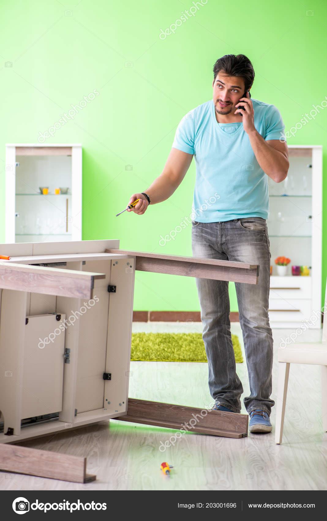 Man Repairing Furniture At Home U2014 Stock Photo