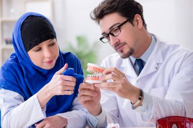 Dentist doctor and assistant working on new tooth implant