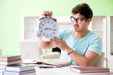 Student preparing for university exams at home in time managemen