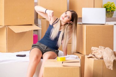 Young woman moving to new place stock vector