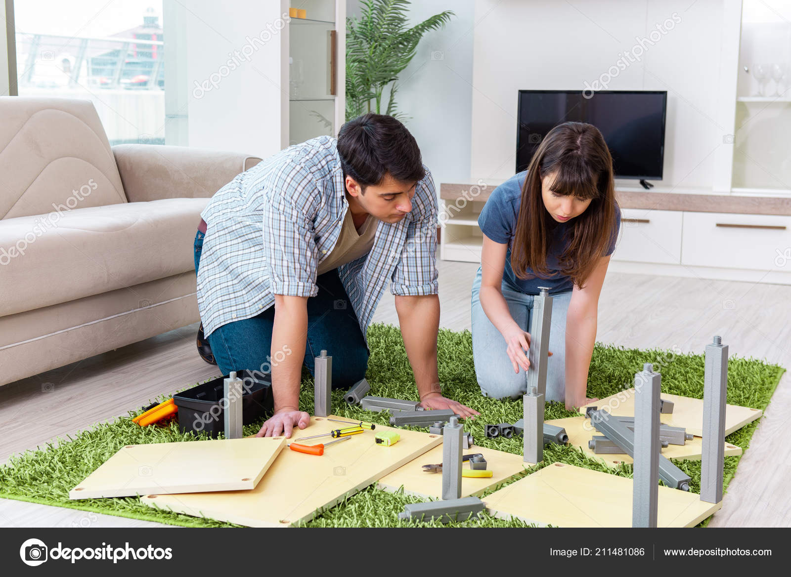 Young Family Assembling Furniture At New House U2014 Stock Photo