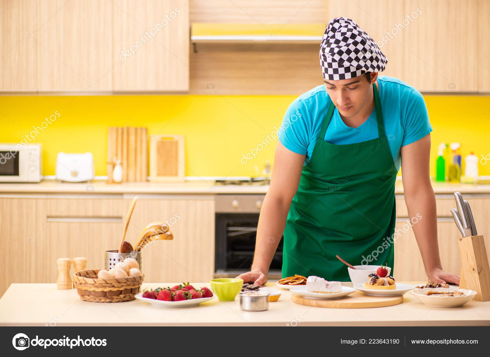 young professional cook preparing in kitchen stock photo elnur