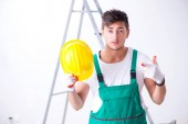 Fotografie Young worker with protective equipment in safety concept