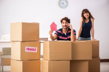 Young family moving to new house apartment