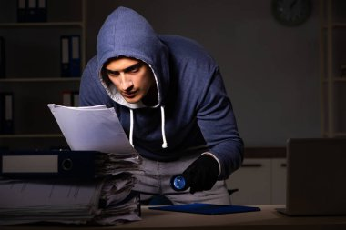 Thief trying to steal personal data in identity theft concept