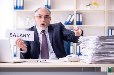 White bearded old businessman employee unhappy with excessive wo