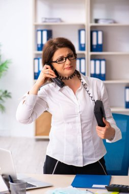 Female employee in budget planning concept