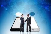 Fotografie Concept of communication with businessmen handshaking