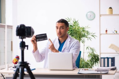 Young doctor recording video for his blog stock vector