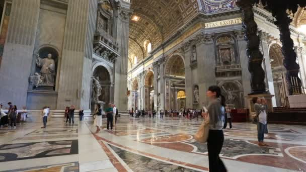 VATICAN - MAY 5, 2014. People in St Peters Basilica. St. Peters Cathedral - a Catholic cathedral, central and largest construction of Vatican, the largest historical Christian church in the world.