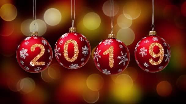 2019 Christmas.Hanging 2019 Number Glitter Christmas Balls On Gold Bokeh Background 4k