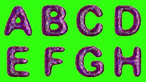 Abeceda z plastu s abstraktní otvory izolované na zeleném pozadí. A B C D E F G H. 4k