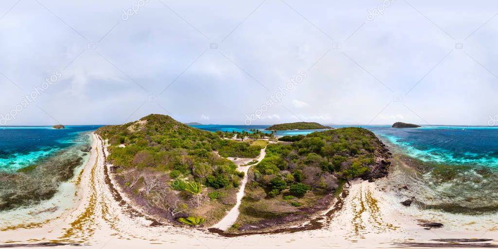 Beautiful 360 degree panorama aerial drone view of tropical islands and turquoise Caribbean sea of Tobago cays in St Vincent and Grenadines
