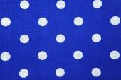 Fotografia macchie bianche su sfondo blu