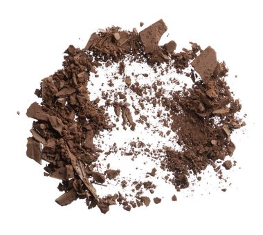 Crushed texture of dark brown eye shadow isolated on white background. Macro texture of broken chocolate powder on white background